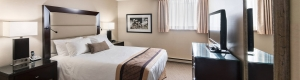 Spacious bedroom with fresh linens in a Queen one bedroom suite at Albert at Bay