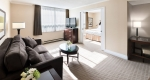 Spacious living area with sofa & television in Albert at Bay accessible suite