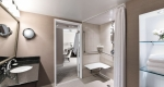 Large accessible shower in a superior king one bedroom suite at Albert at Bay