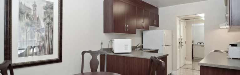 Spacious kitchen in a superior king one bedroom suite at Albert at Bay
