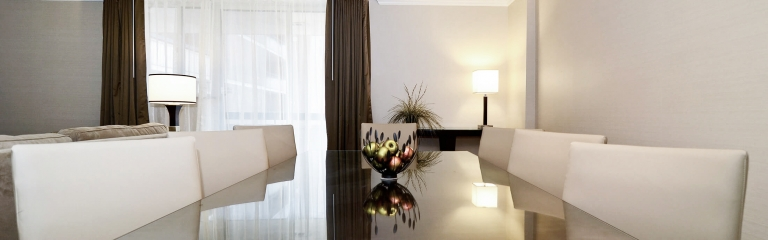 8 place setting dining table in a superior king one bedroom suite at Albert at Bay