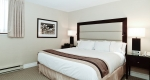 Large bed with fresh linen in a superior one bedroom suite at Albert at Bay