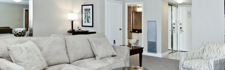 Couch, armchair and coffee table in a superior king suite at Albert at Bay