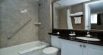 Spacious bathroom with tub and shower in Superior King One Bedroom Suite