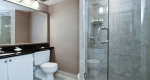 Bathroom with glass shower in superior king one bedroom suite at Albert at Bay