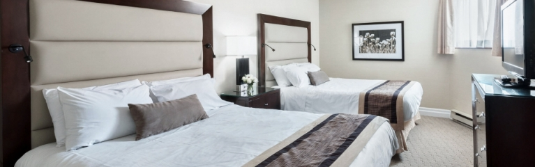 Two large double beds in a superior king one bedroom suite at Albert at Bay
