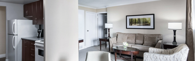 View of dining & living area in the spacious superior king one bedroom suite at Albert at Bay
