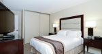Large bedroom with freshly made bed in superior king one bedroom suite at Albert at Bay