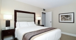 Large bed with plush pillows in a superior king one bedroom suite at Albert at Bay