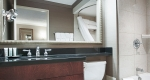 Stylish bathroom fixtures in a superior king one bedroom suite at Albert at Bay