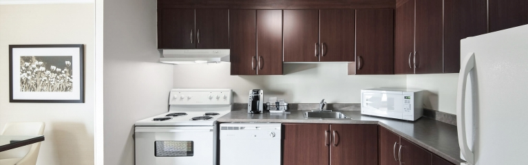 A large kitchen counter in a superior king one bedroom suite at Albert at Bay