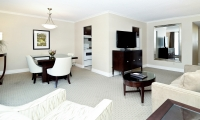 Living room and dining area in a superior king one bedroom suite at Albert at Bay