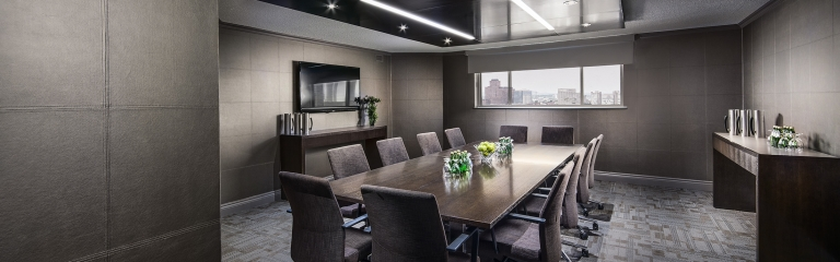 Large boardroom table surrounded by chairs in the chelsea boardroom